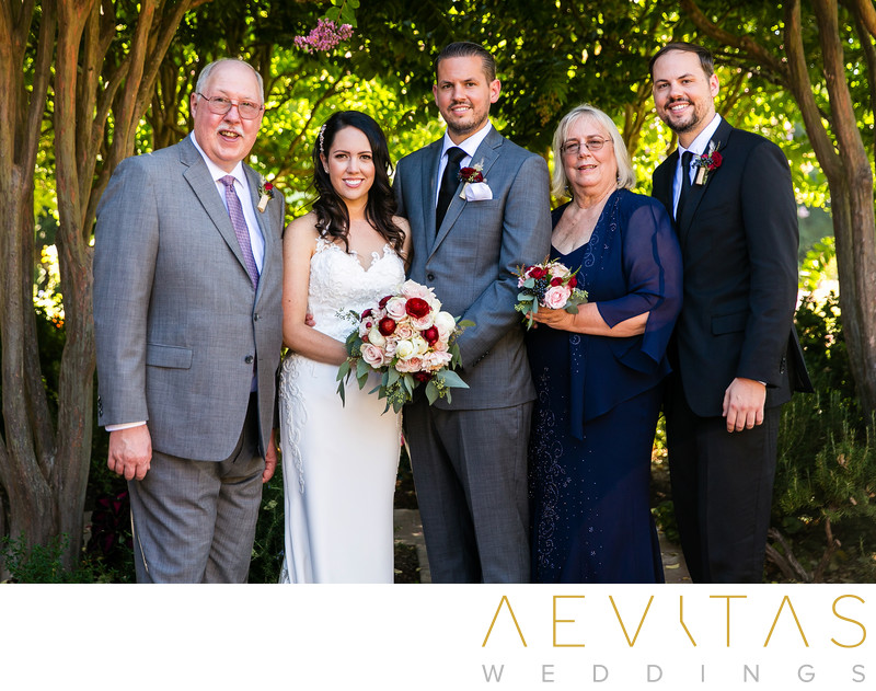 Couple portrait with groom's family Landmark Vineyards