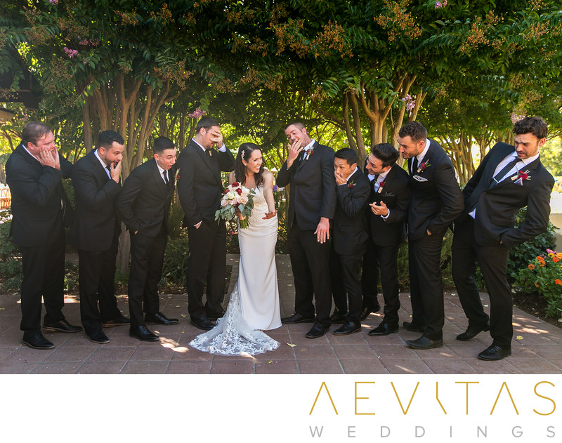 Fun bride with groomsmen portrait at Landmark Vineyards