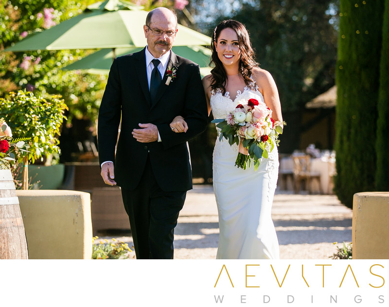 Bride and dad walking down aisle at Landmark Vineyards