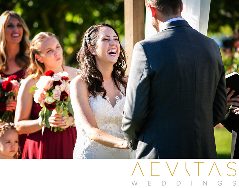 Bride laughing at Landmark Vineyards wedding ceremony