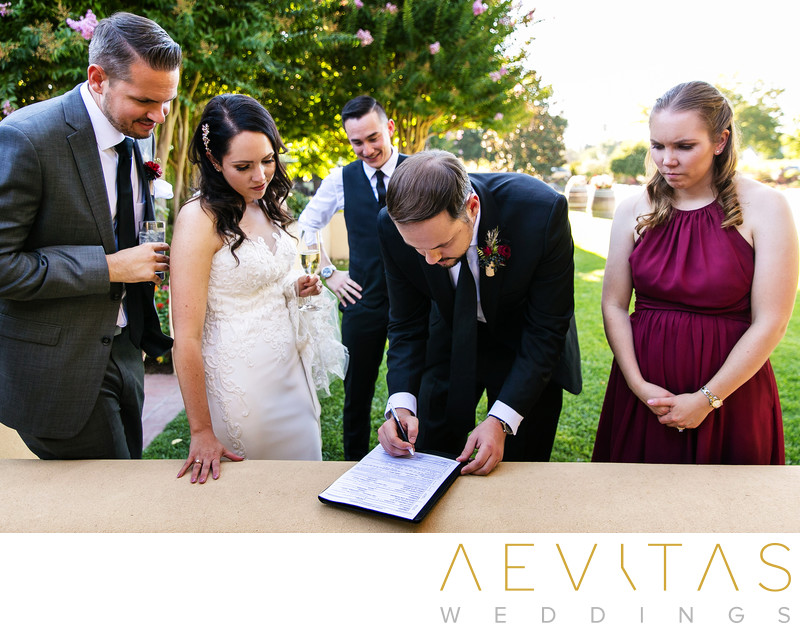 Best man signing marriage license at Kenwood wedding