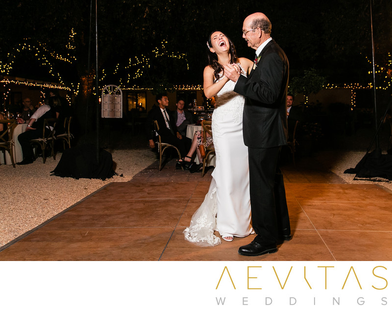 Bride laughing during father-daughter dance in Kenwood