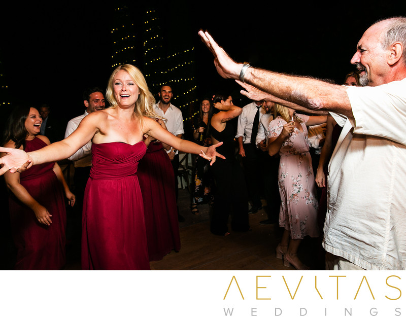 Bridesmaid dancing with guest at Kenwood wedding