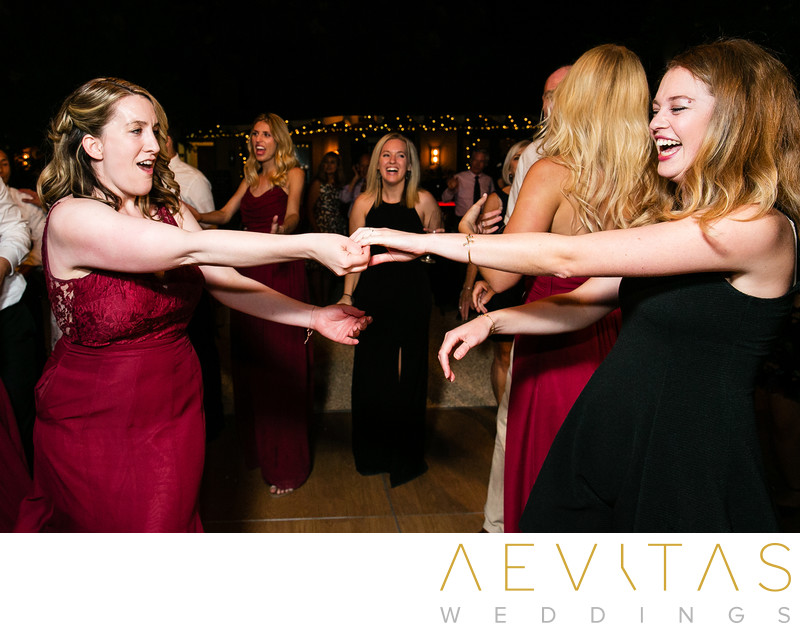 Bridesmaid dancing with friend at Kenwood reception