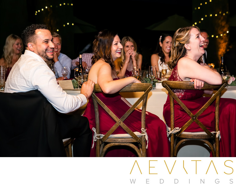 Bridal party laughing at Kenwood wedding reception