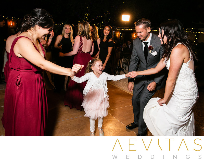 Couple dancing with flower girl at Landmark Vineyards