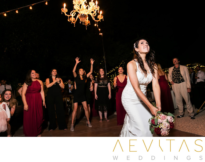 Bride bouquet toss at Landmark Vineyards wedding