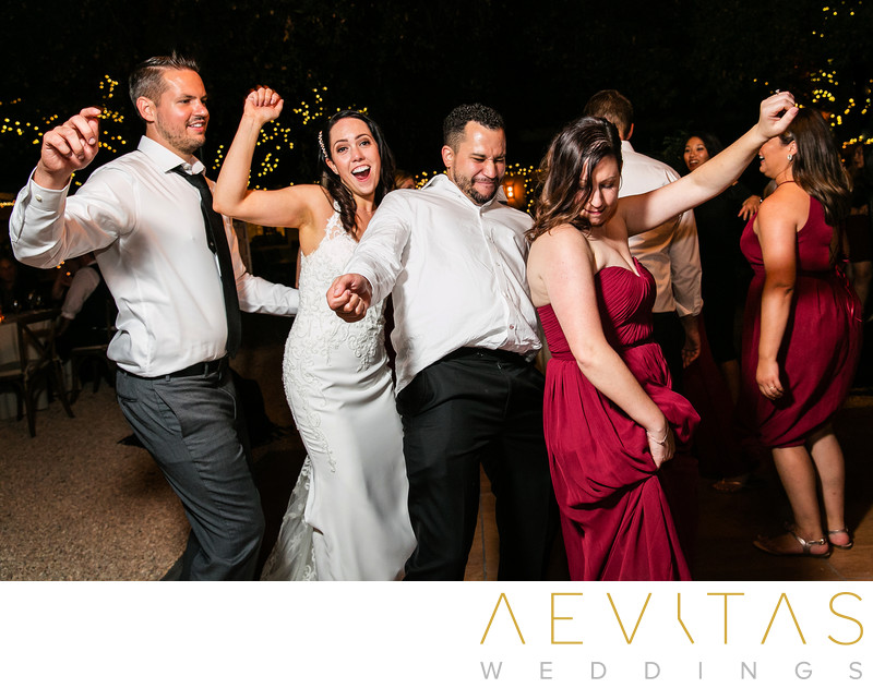 Couple dancing with friends at Kenwood reception