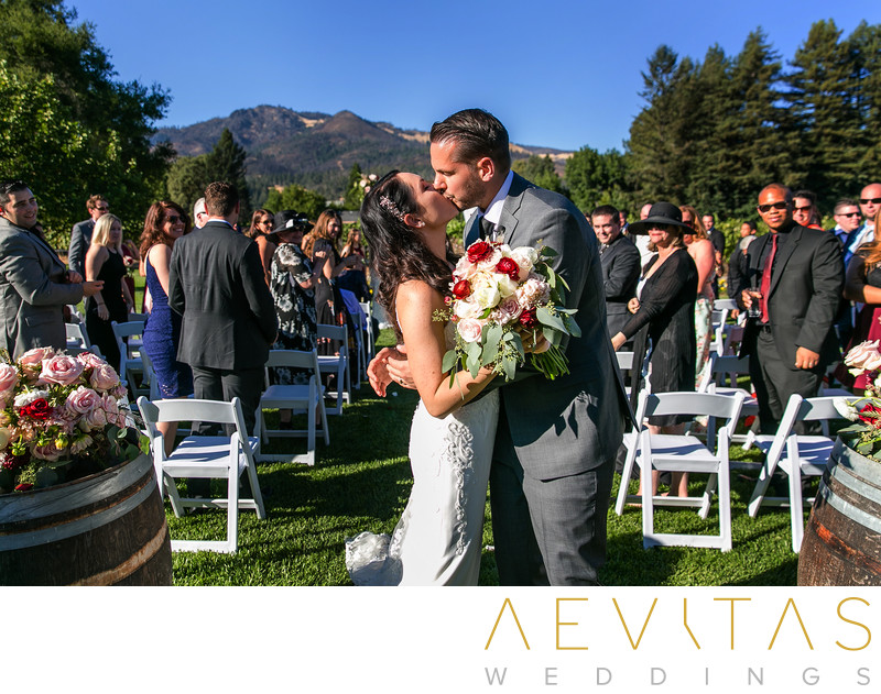 Couple kiss during recessional at Landmark Vineyards