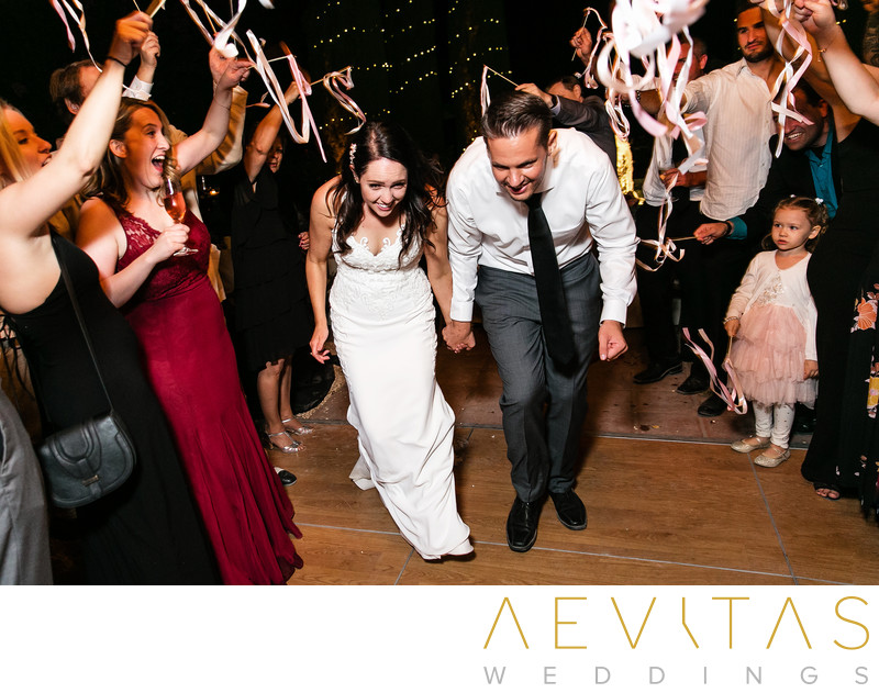 Couple grand exit with streamers at Landmark Vineyards