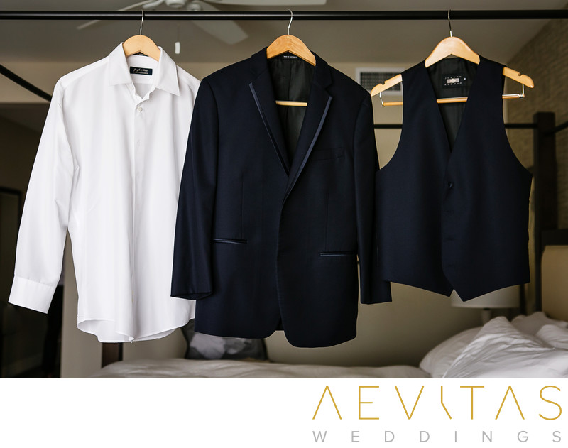 Groom's suit and shirt hanging in Terranea Resort suite