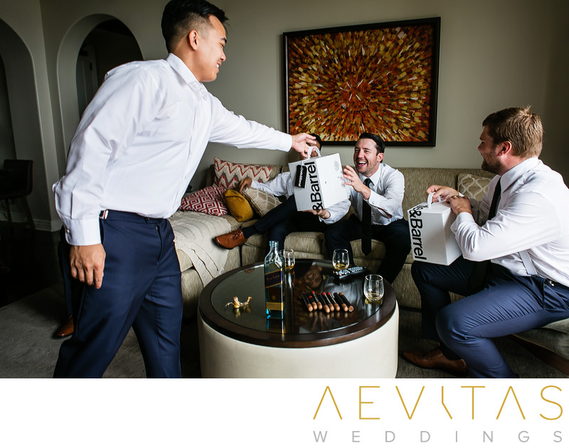 Groom giving gifts to groomsmen at Terranea Resort