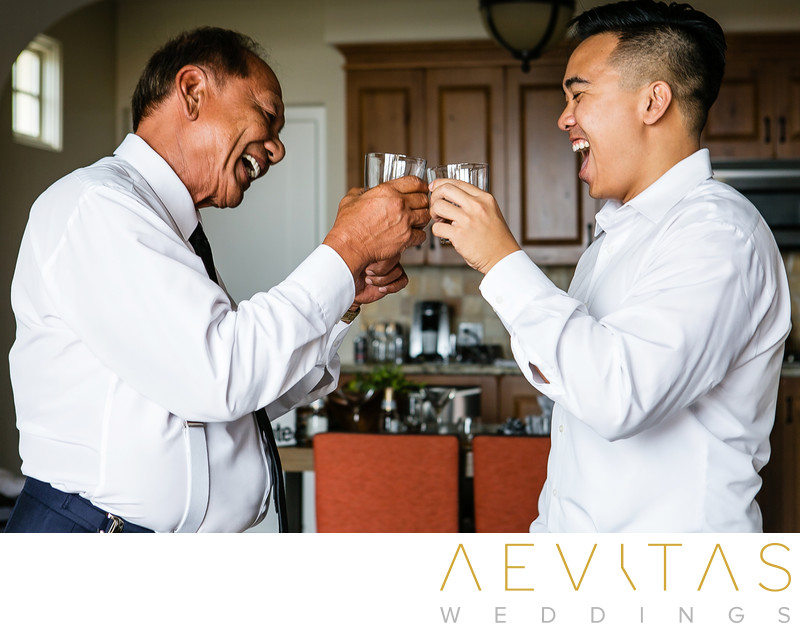 Groom toasting with dad in Terranea Resort suite