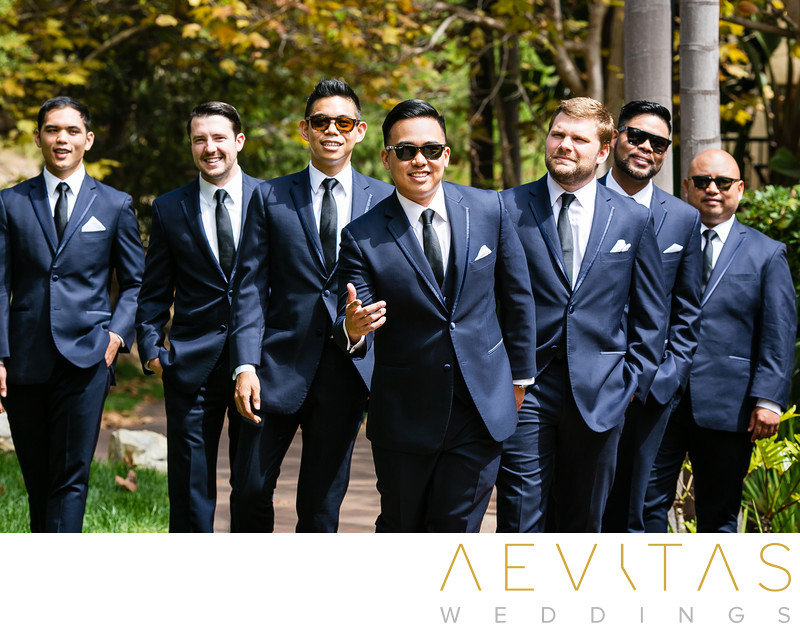 Fun groomsmen portrait in Terranea Resort gardens
