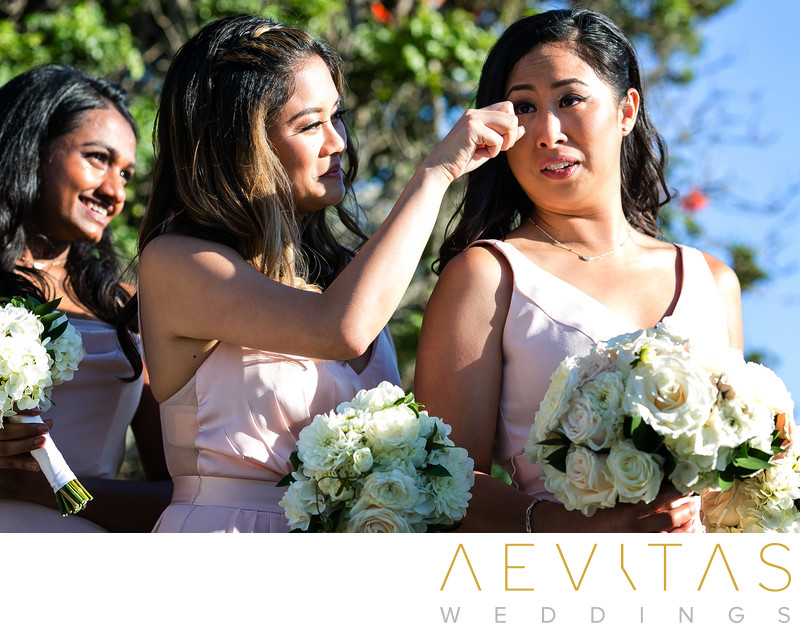 Bridesmaids wiping tears at Rancho Palos Verdes wedding