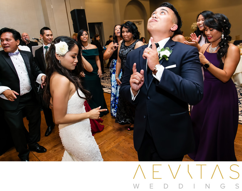 Playful couple dancing at Rancho Palos Verdes wedding