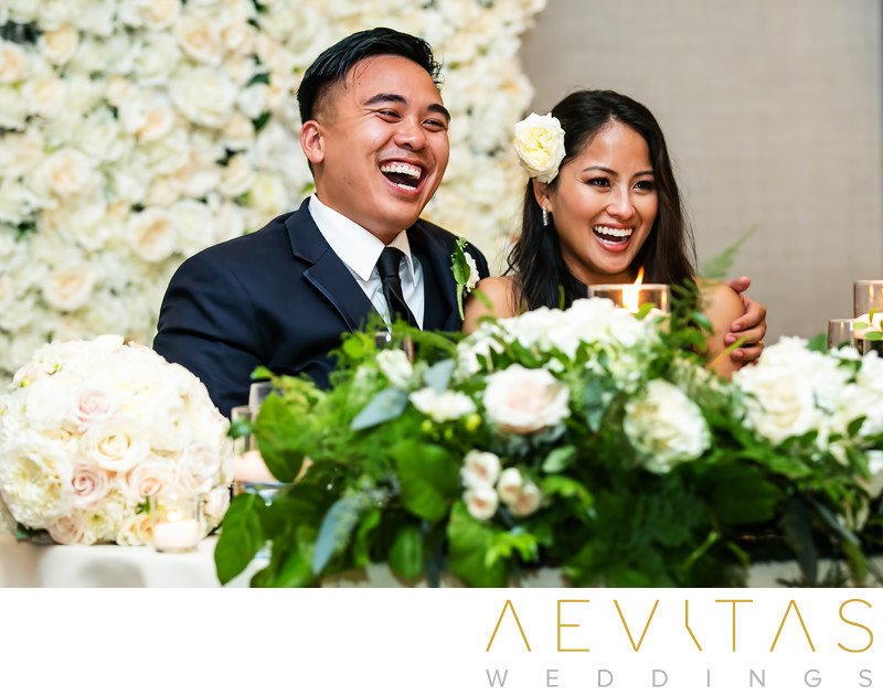 Couple laughing at sweetheart table Rancho Palos Verdes