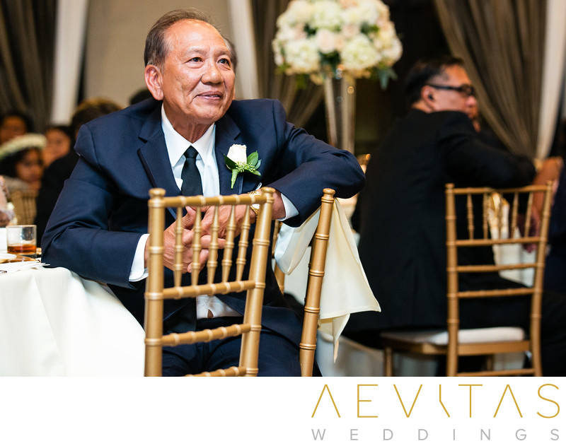 Father-of-the-bride listening to reception speech