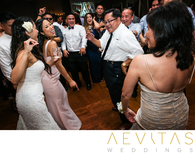 Bride dancing with family at Trump National Golf Club