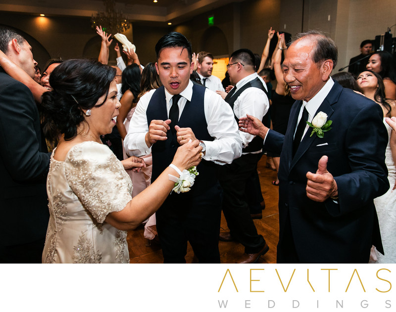 Groom dancing with parents at Trump National Golf Club