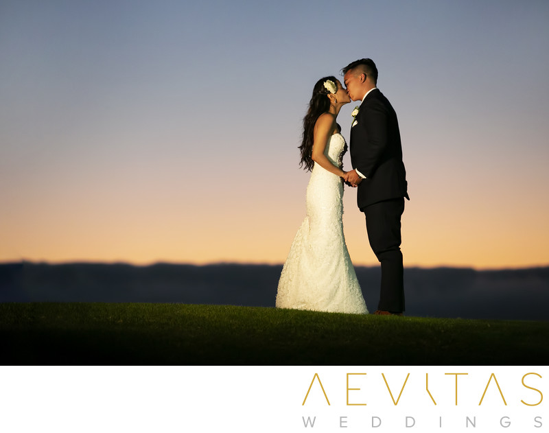 Couple kiss sunset portrait Trump National Golf Club