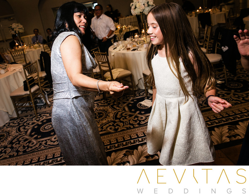 Mother and daughter dancing at ballroom reception