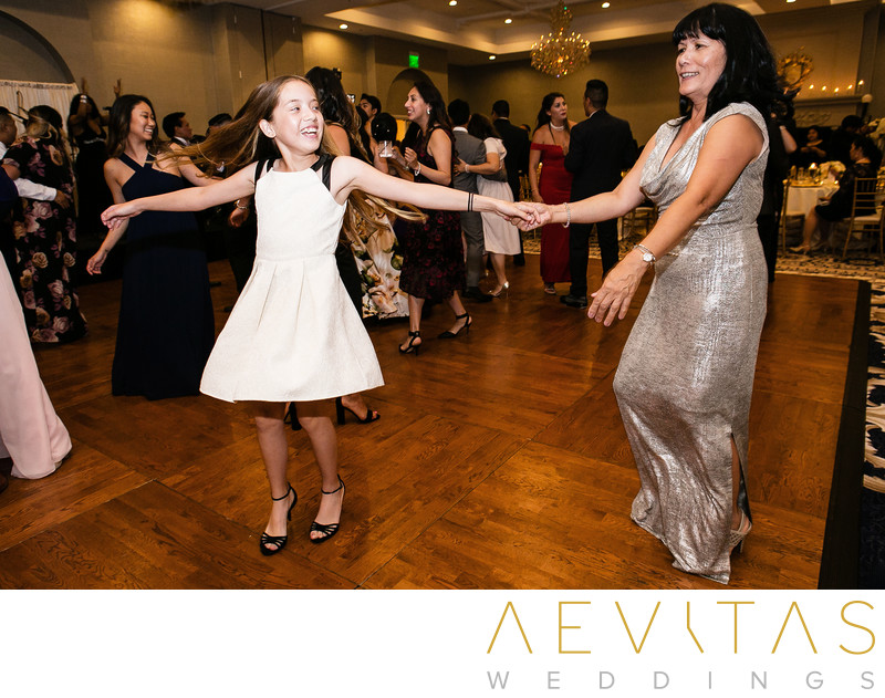 Mom and daughter dancing at Rancho Palos Verdes wedding