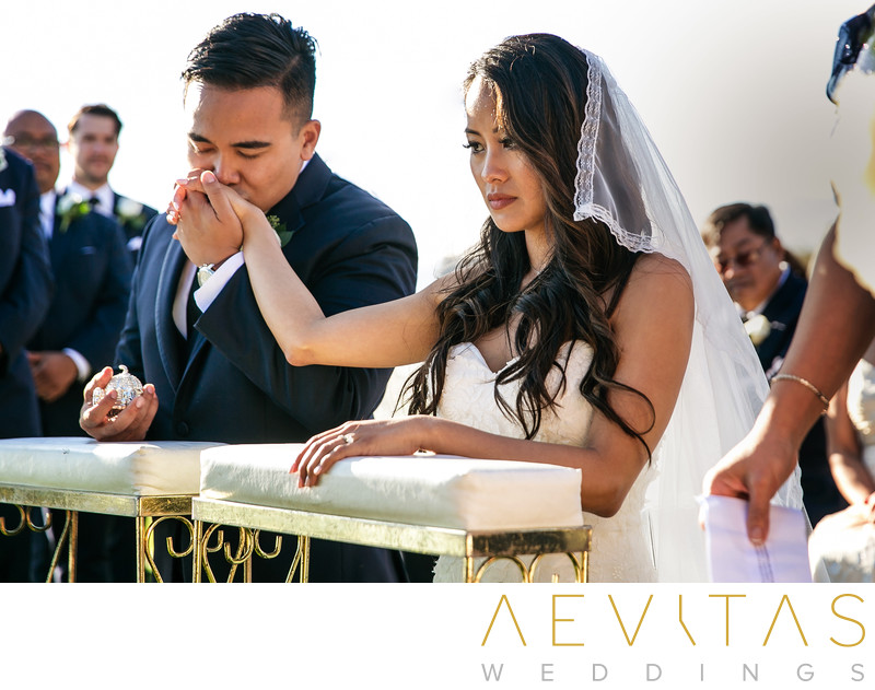 Groom kisses bride's hand Catholic Filipino wedding