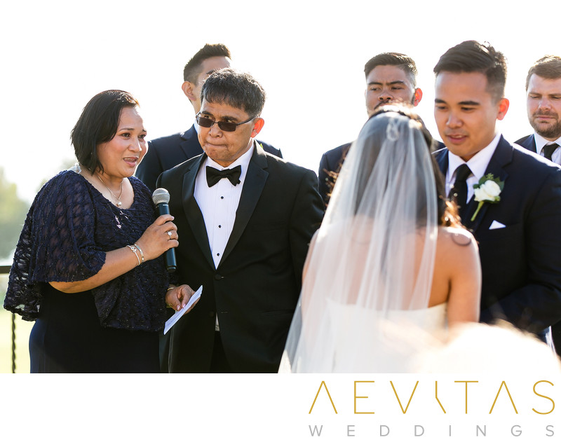 Godparents reading with couple at Filipino wedding