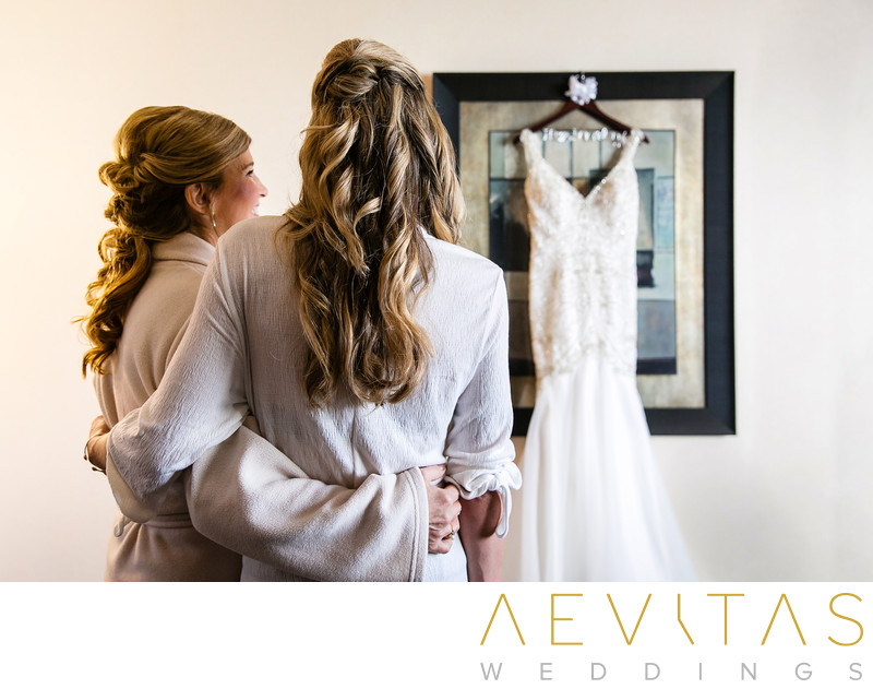 Bride and mom admiring wedding dress San Clemente