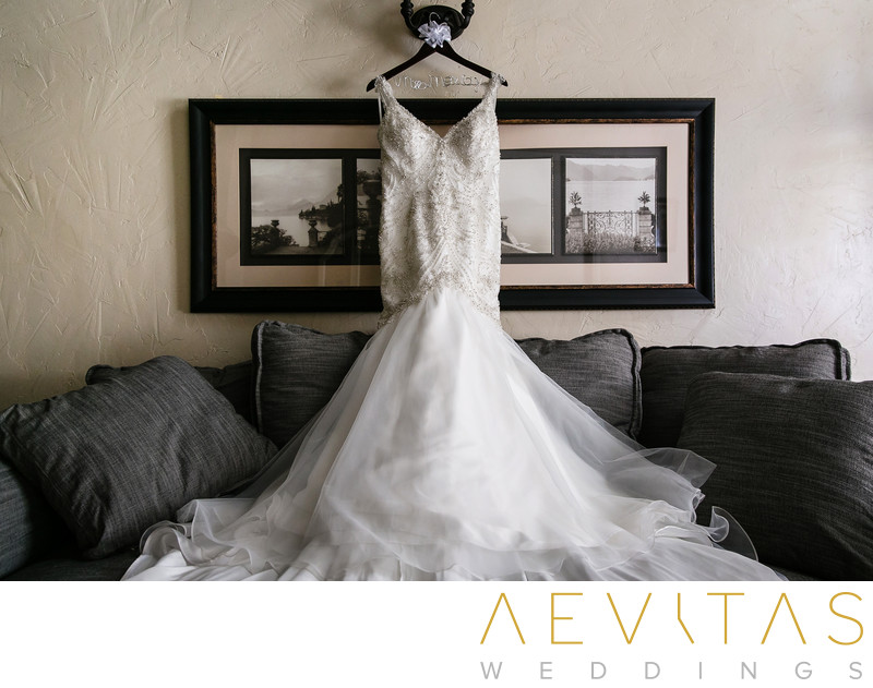 Wedding dress hanging in elegant Orange County suite