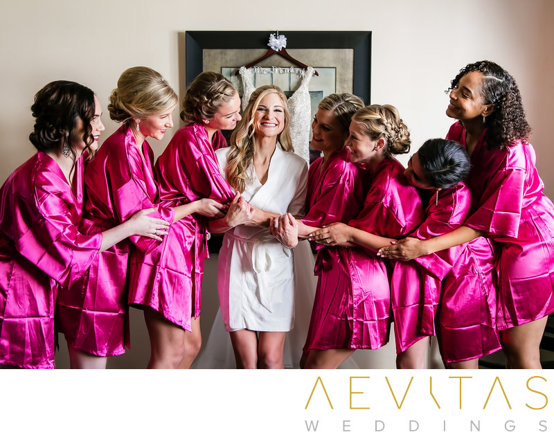 Bridesmaids embracing bride San Clemente wedding