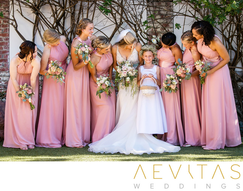 Bridesmaids looking at flower girl San Clemente wedding