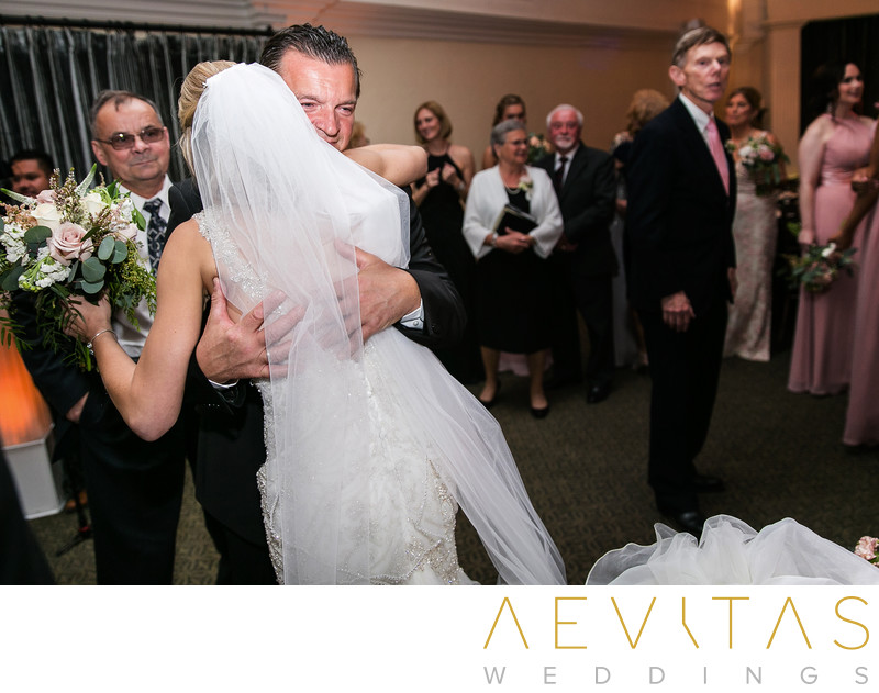 Bride hugging dad after Casino San Clemente wedding