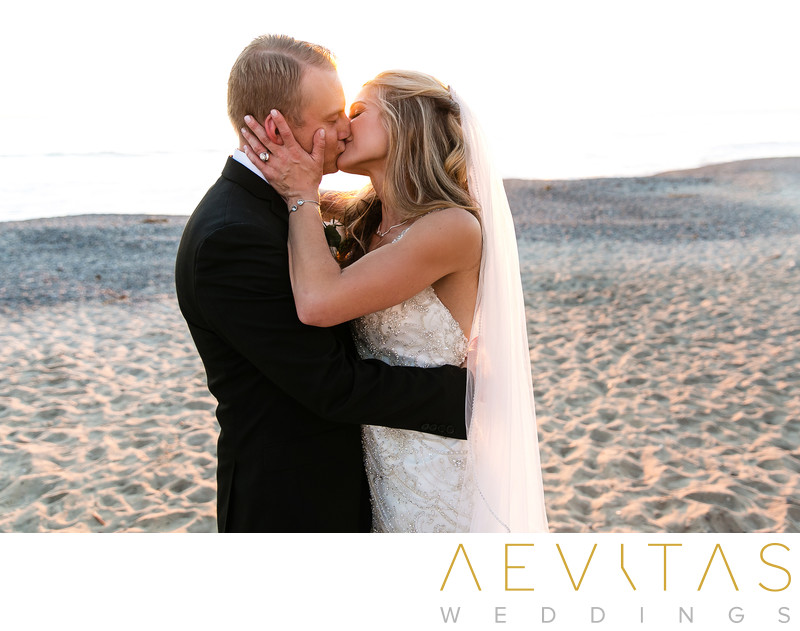 Couple kiss sunset wedding portrait San Clemente beach