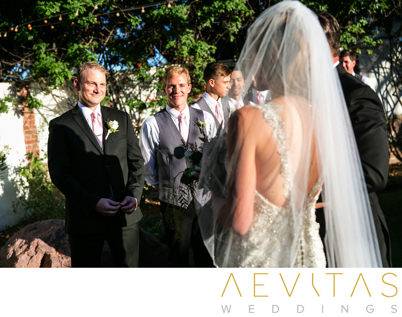Groom smiling at bride Casino San Clemente wedding