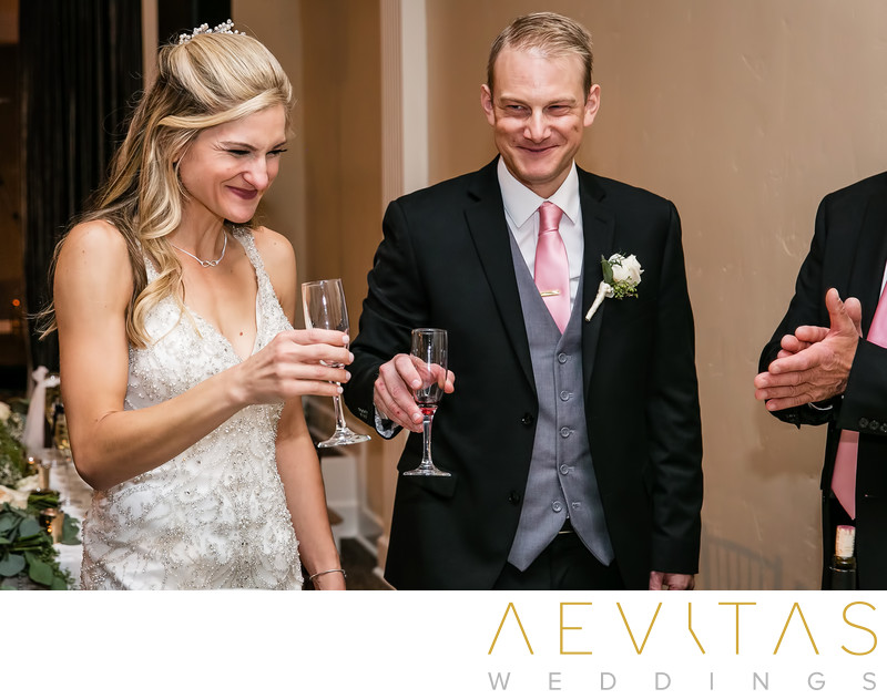 Couple smiling after drinking wine at Jewish wedding