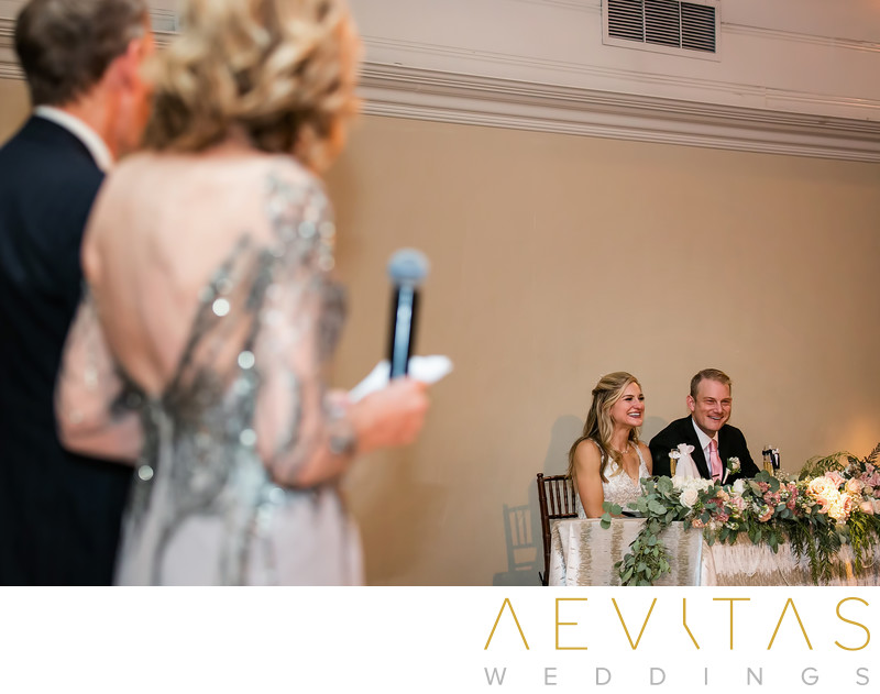 Parents' speech with couple at sweetheart table