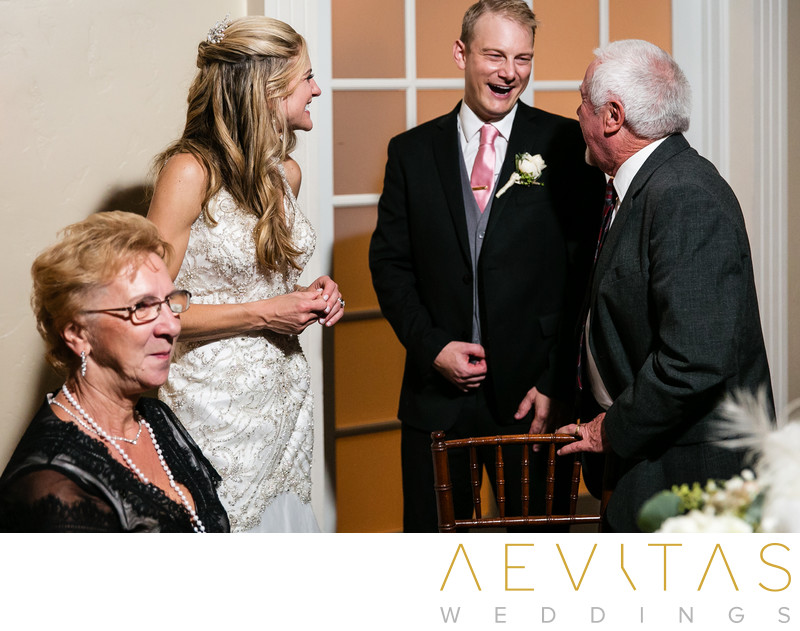 Couple with grandparents at Casino San Clemente wedding