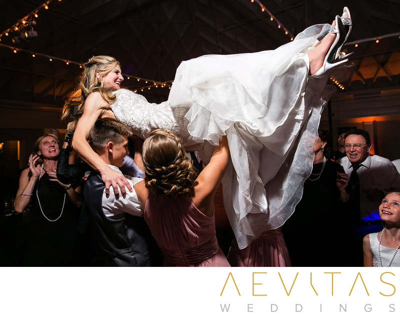Bride lifted above dance floor at Casino San Clemente