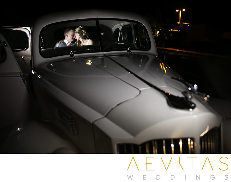 Couple in classic car by LA wedding photographer