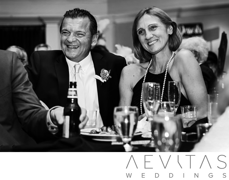 Black and white candid parent reaction at reception