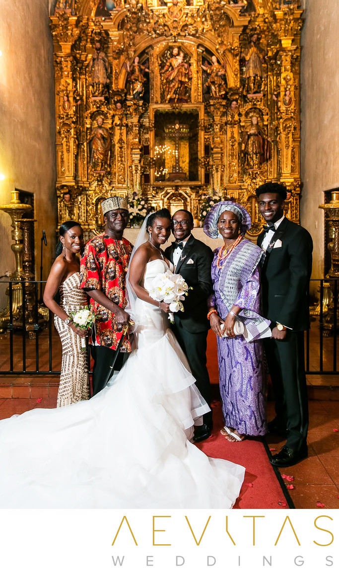 Family formal at gilded altar of Saint Francis Chapel