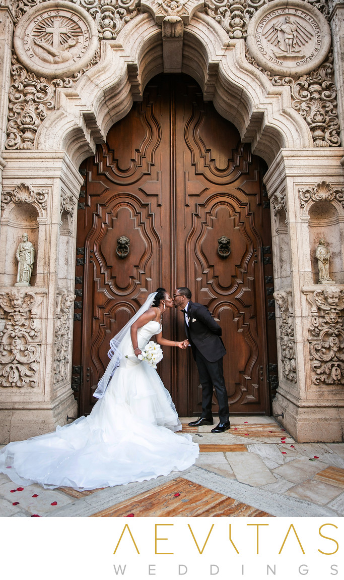 Couple kiss outside Mission Inn wooden doorway