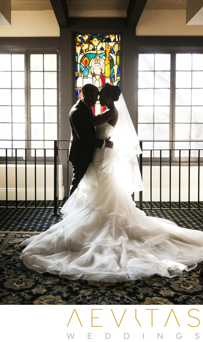 Couple portrait in front of stained glass window