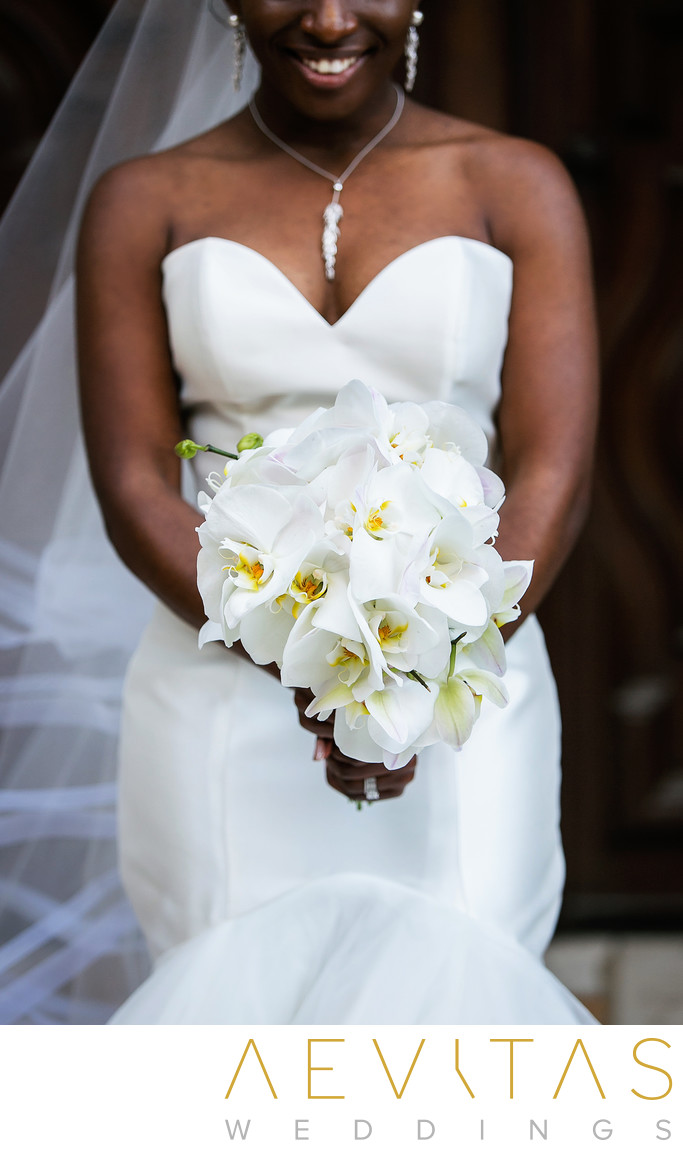 Creative bride portrait with bouquet at Mission Inn