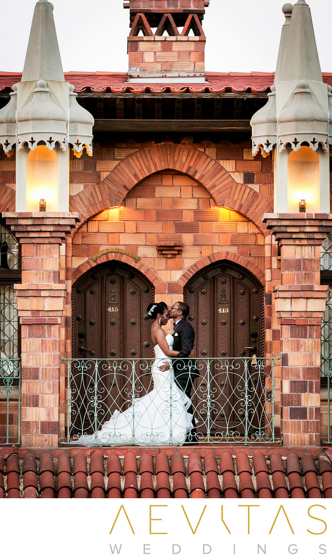 Couple portrait with red brick architecture Riverside