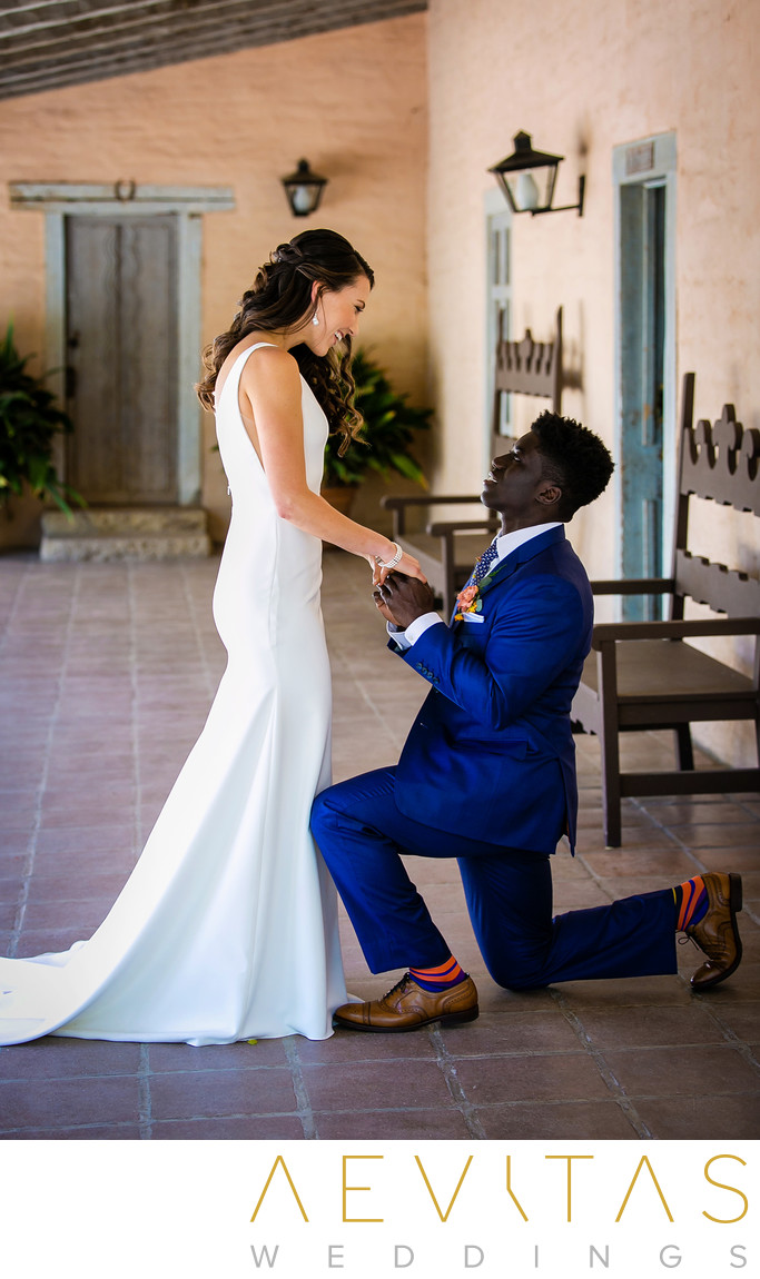 Groom gets down on one knee during couple first look
