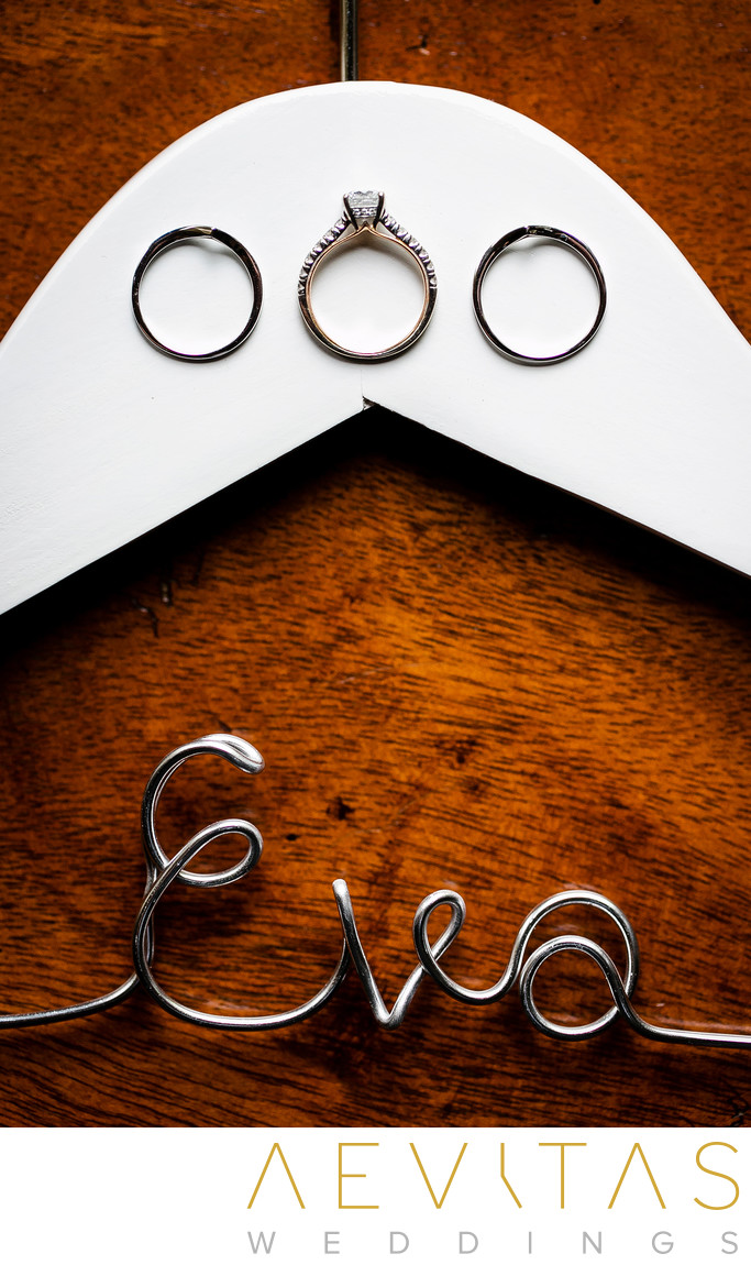 Wedding ring details and hangar with Eva name