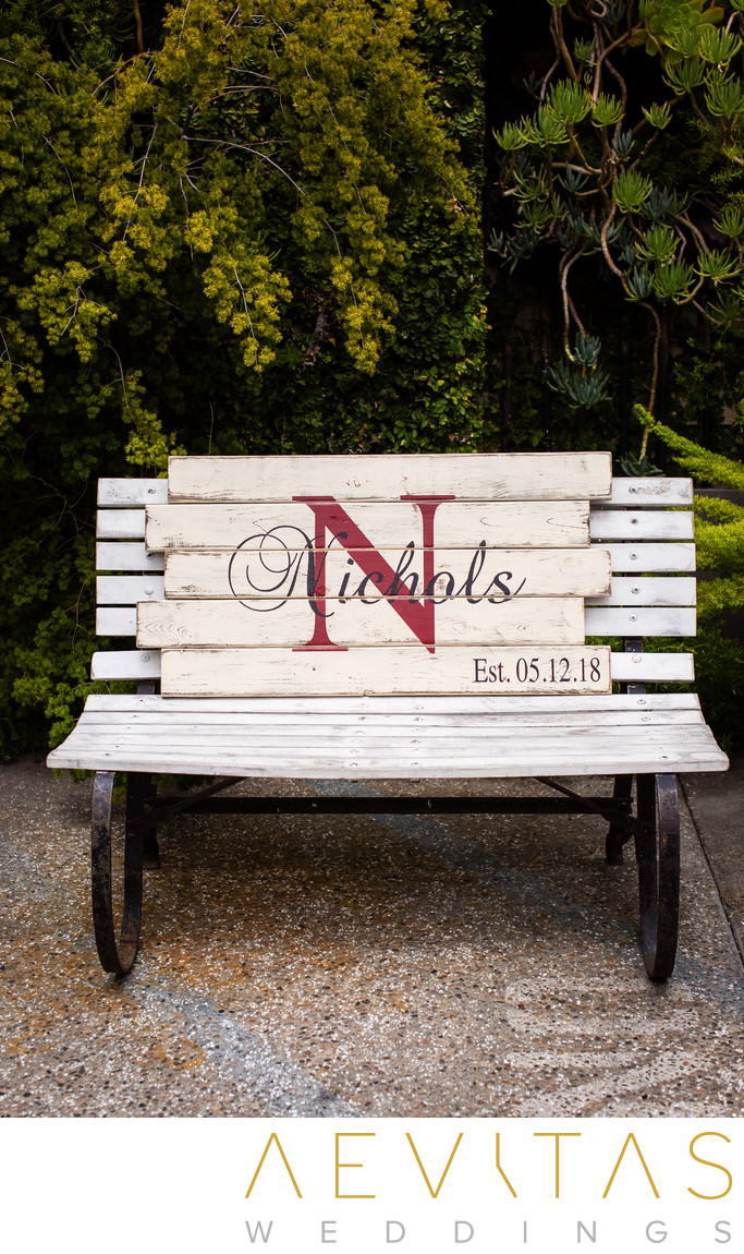 Rustic wooden bench with Nichols sign at SmogShoppe
